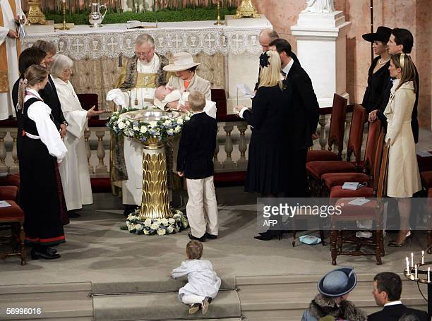 Norwegian Prince Sverre Magnus in his grandmother Queen Sonja's arms is baptised 04 March 2006 next to Oslo's Bishop Ole Christian Kvarme in the...