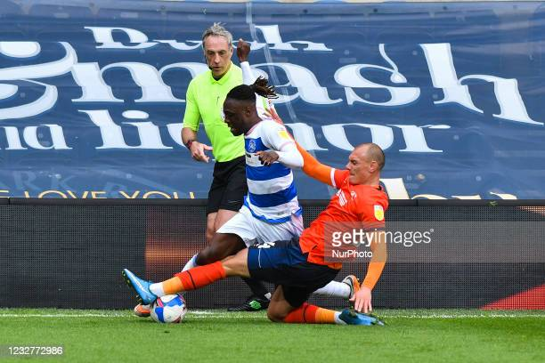 Osman Kakay of QPR battles for possession with Kal Naismith of Luton town during the Sky Bet Championship match between Queens Park Rangers and Luton...
