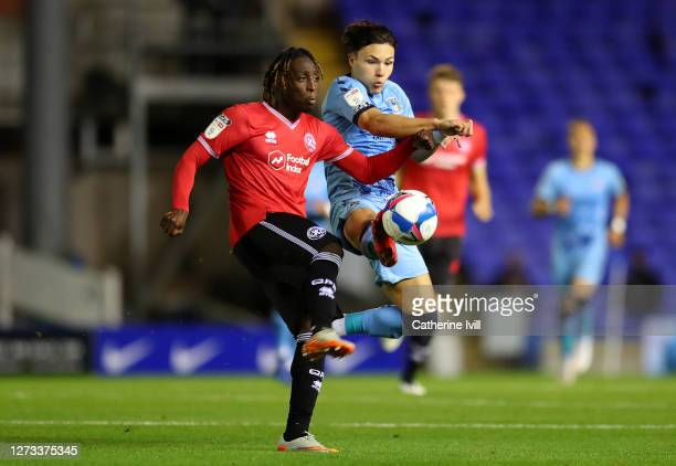 Osman Kakay of QPR challenges Callum O'Hare of Coventry during the Sky Bet Championship match between Coventry City and Queens Park Rangers at St...