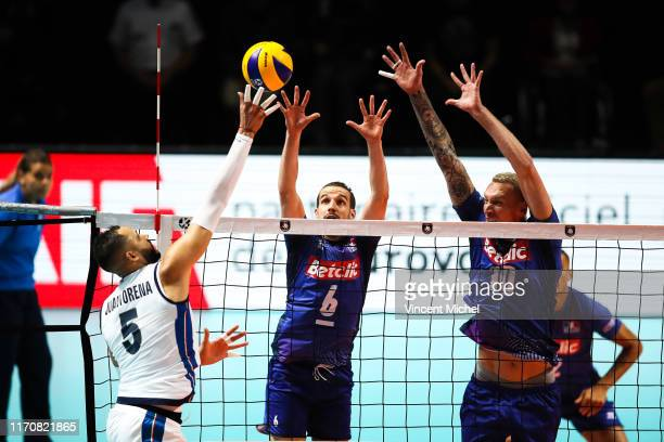 Osmany JUANTORENA of Italy and Benjamin TONIUTTI and Kevin LE ROUX of France during the EuroVolley Quarter final match between France and Italy on...