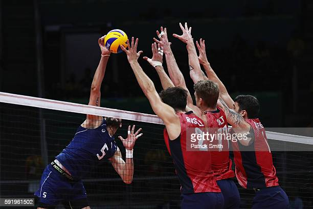 Osmany Juantorena of Italy spikes the ball against the United States defence during the Men's Volleyball Semifinal match on Day 14 of the Rio 2016...