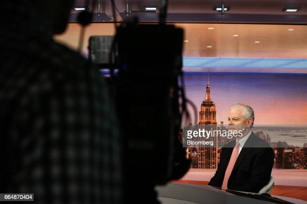 Osmar Abib cohead of global energy group at Credit Suisse Group AG listens during a Bloomberg Television interview in New York US on Wednesday April...