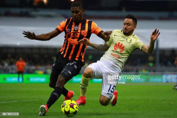 Osmar Mares of America struggles for the ball with Brayan Beckeles of Necaxa during the 10th round match between America and Necaxa as part of the...