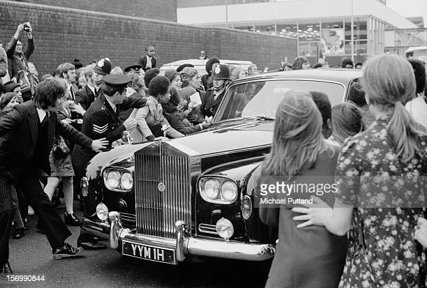 Osmonds fans crowd around the group's Rolls Royce after their arrival at London Airport 29th October 1972