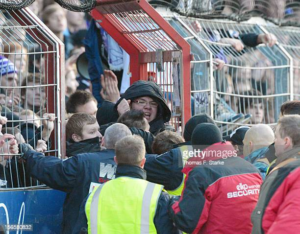 Osnabruck supporters pry open a gate and clash with security after the Third League match between between VfL Osnabrueck and Arminia Bielefeld at...