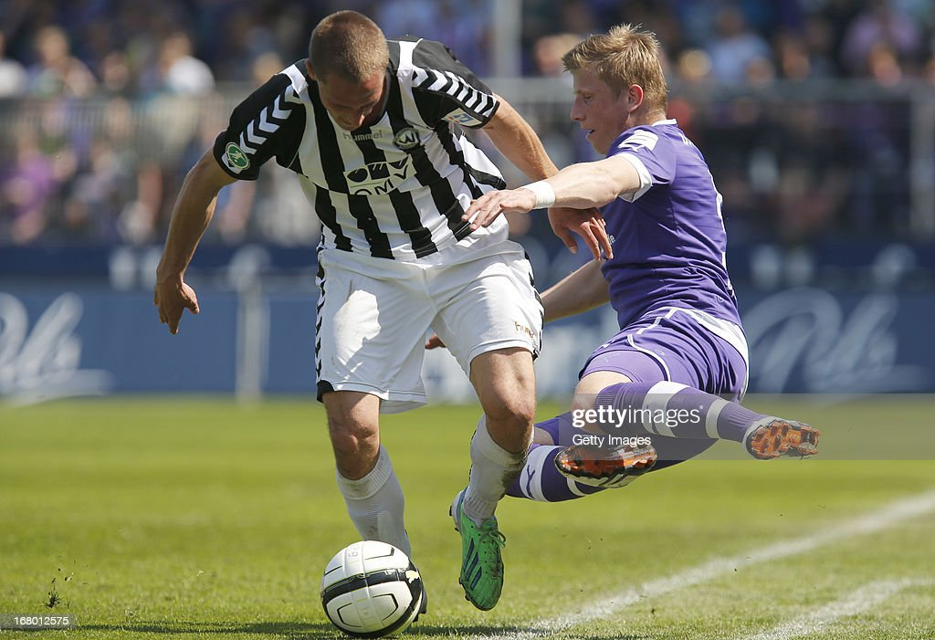 Osnabrueck's Marcus Piossek and Burghausen's Ulrich Taffertshofer vie for the ball during the Third League match between VfL Osnabrueck and Wacker Burghausen at Osnatel Arena on May 4, 2013 in Osnabruck, Germany.