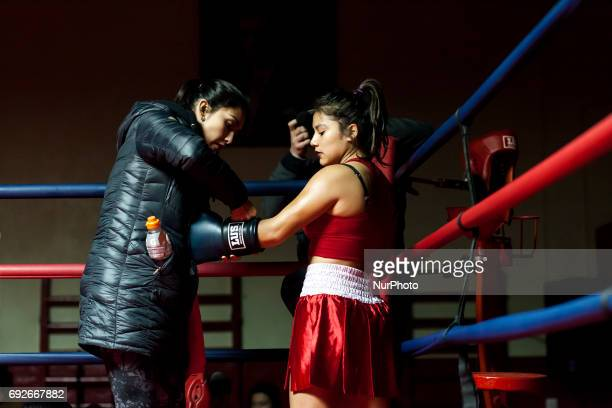 Osorno Chile 2 June 2017 Kim Sandoval and Tamara Mancilla receive instructions from the referee before the match Kim Sandoval an amateur boxer 15...