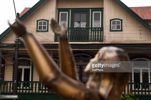Osorno Chile 23 may 2019 Steel statue on a concrete plinth The figurative sculpture represents a person with his arms held high symbolizing the...