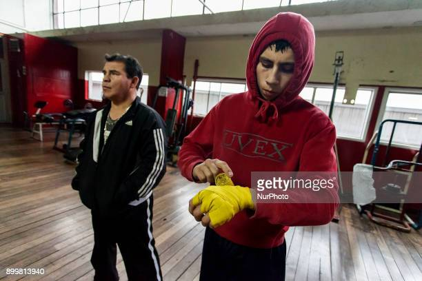 Osorno Chile 29 December 2017 Vicente young boxer preparing to begin training In the Club Mexico of the city of Osorno the last boxing trainings of...