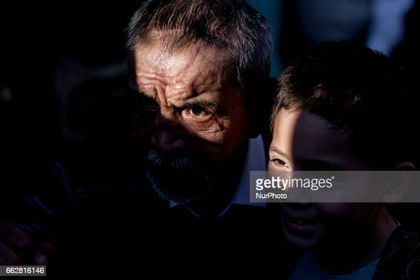 Osorno Chile 31 March 2017 Martin Vargas poses with a child for a photograph In the city of Osorno a monument was inaugurated in honor of Chilean...