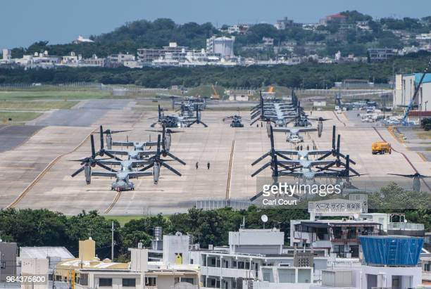 Osprey aircraft sit on a runway at Marine Corps Air Station Futenma on May 31 2018 in Ginowan Okinawa prefecture Japan Demonstrators protesting...