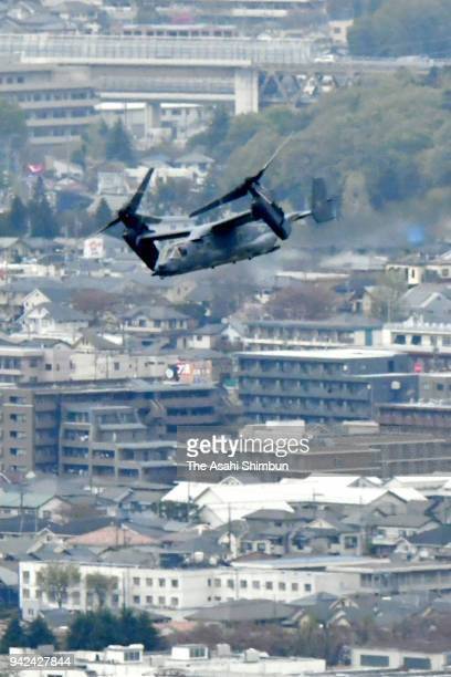 A CV22 Osprey flies past Mresidential district near the US Yokota Air Base on April 5 2018 in Fussa Tokyo Japan The transport aircraft will be...