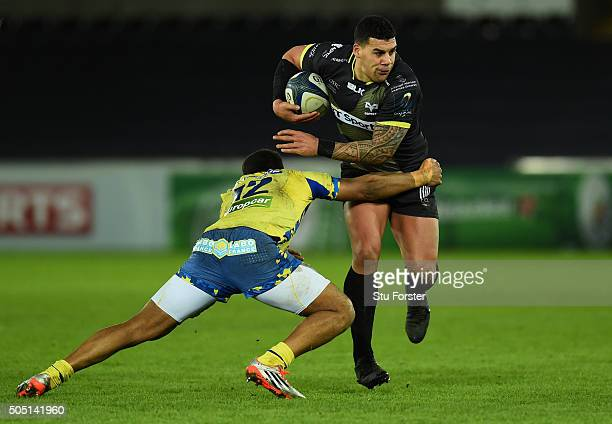 Ospreys centre Josh Matavesi is tackled by Wesley Fofana of Clermont during the European Rugby Champions Cup Pool 2 match between Ospreys v ASM...