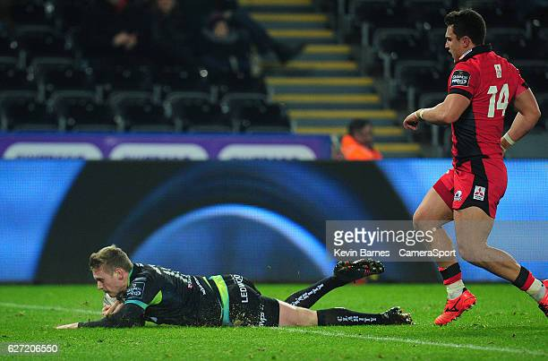Ospreys' Dafydd Howells scores his sides first try during the Guinness PRO12 Round 10 match between Ospreys and Edinburgh Rugby at Liberty Stadium on...