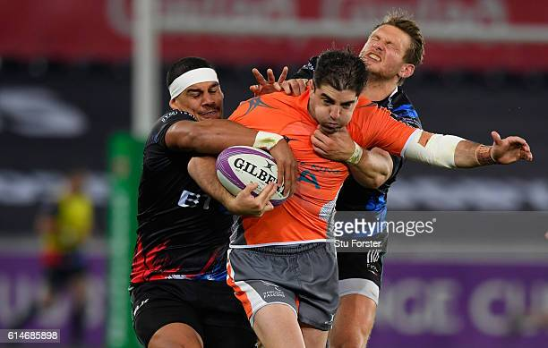 Ospreys fly half Dan Biggar and Josh Matavesi combine to tackle Falcons wing Beliusario Agulla during the European Rugby Challenge Cup match Ospreys...