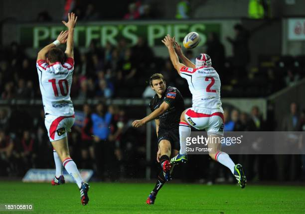 Ospreys fly half Dan Biggar has his attempted drop goal kick knocked down by Ulster hooker Rory Best during the RaboDirect Pro 12 match between...