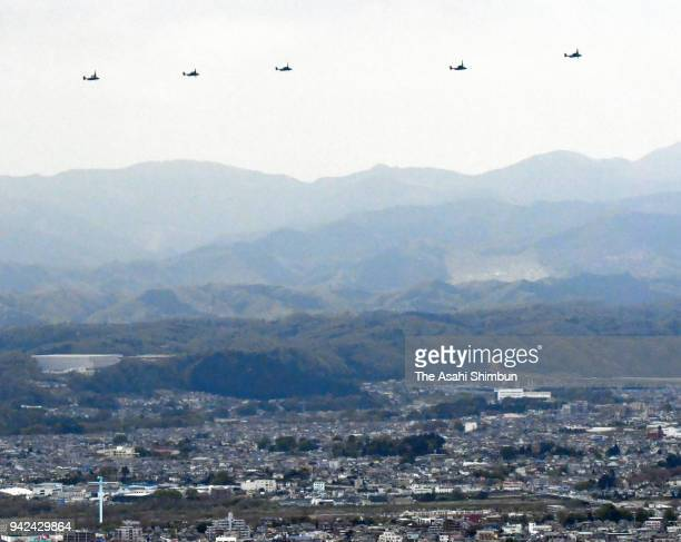 CV22 Ospreys fly past residential district near the US Yokota Air Base on April 5 2018 in Fussa Tokyo Japan The transport aircraft will be deployed...