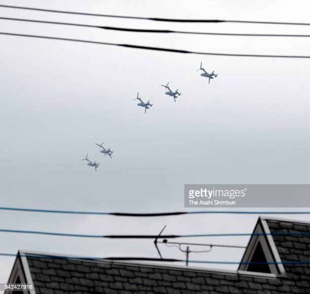 CV22 Ospreys fly past rresidential district near the US Yokota Air Base on April 5 2018 in Akiruno Tokyo Japan The transport aircraft will be...