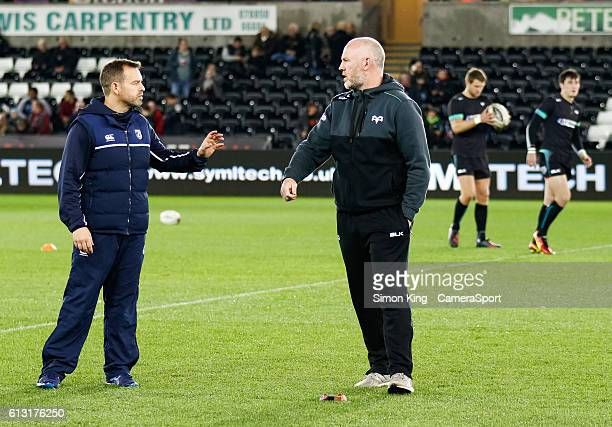 Ospreys' Head Coach Steve Tandy with Cardiff Blues' Head Coach Danny Wilson during the pre match warm up during the Guinness PRO12 Round 6 match...