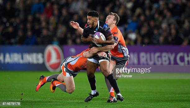 Ospreys Keelan Giles is wrapped up by Freddie Burdon and Craig Willis of the Falcons during the European Rugby Challenge Cup match Ospreys and...