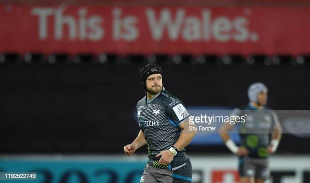Ospreys player Dan Evans leaves the field after being sent off in the first minute of the game during the Heineken Champions Cup Round 3 match...