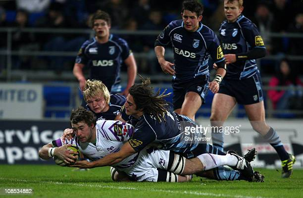 Ospreys player Morgan Allen dives over to score during the LV Anglo Welsh Cup match between Cardiff Blues and Ospreys at Cardiff City Stadium on...