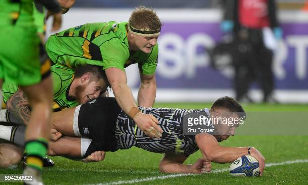 Ospreys player Rhys Webb dives over to score the second Ospreys try during the European Rugby Champions Cup match between Ospreys and Northampton...