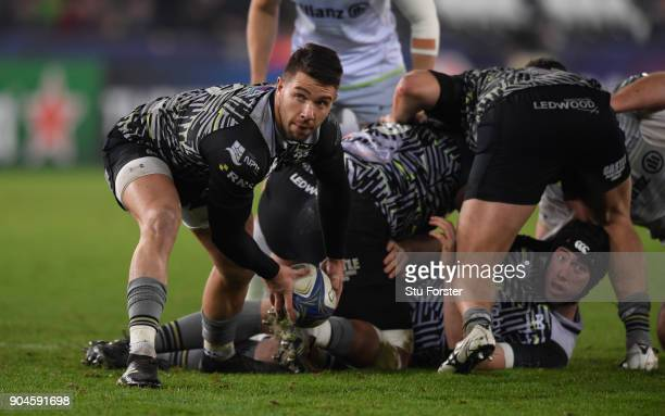 Ospreys player Rhys Webb passes from a scrum during the European Rugby Champions Cup match between Ospreys and Saracens at Liberty Stadium on January...