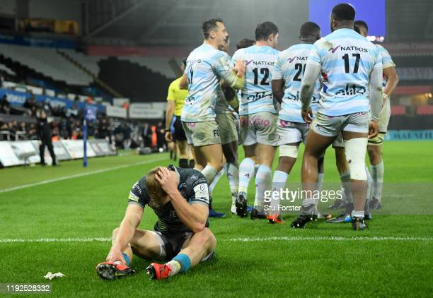 Ospreys scrum half Aled Davies reacts after Racing celebrate a try by captain Henry Chavancy during the Heineken Champions Cup Round 3 match between...