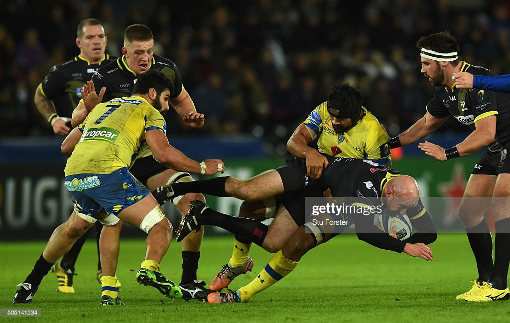 Ospreys scrum half Brendon Leonard is tackled by Fritz Lee of Clermont during the European Rugby Champions Cup Pool 2 match between Ospreys v ASM Clermont Auvergne at Liberty Stadium on January 15, 2016 in Swansea, Wales.