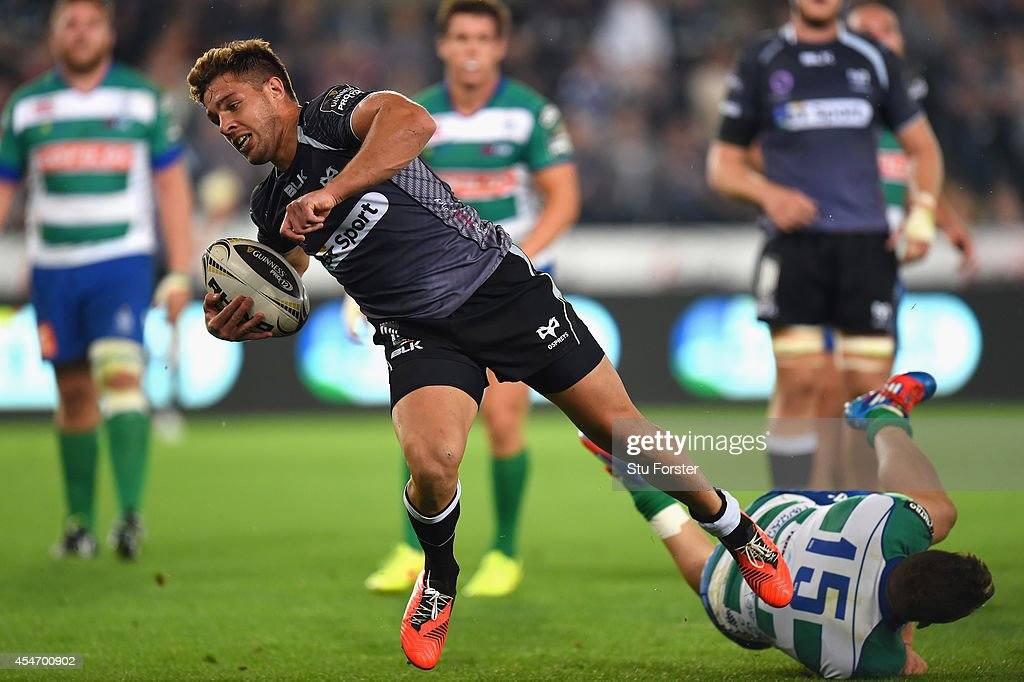 Ospreys scrum half Rhys Wwebb makes a break to score the second try during the Guinness Pro 12 match between Ospreys and Benetton Rugby Treviso at Liberty Stadium on September 5, 2014 in Swansea, United Kingdom.