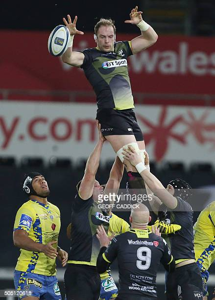 Ospreys' Welsh lock Alun Wyn Jones wins a line out ball during the European Rugby Champions Cup group stage match between Ospreys and Clermont...