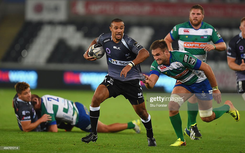 Ospreys wing Eli Walker makes a break during the Guinness Pro 12 match between Ospreys and Benetton Rugby Treviso at Liberty Stadium on September 5, 2014 in Swansea, United Kingdom.