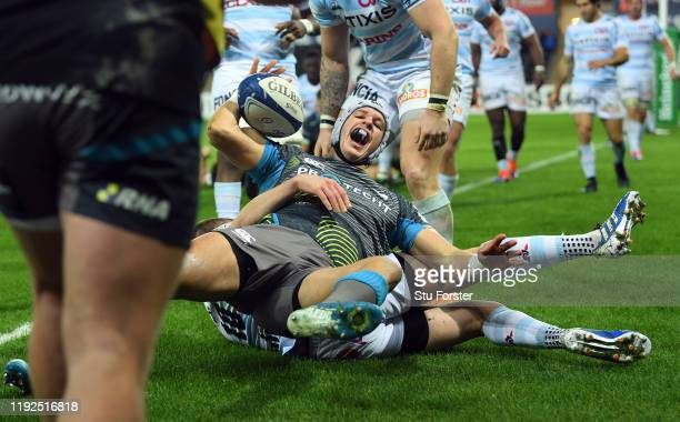 Ospreys wing Hanno Dirksen celebrates after scoring the first try during the Heineken Champions Cup Round 3 match between Ospreys and Racing 92 at...