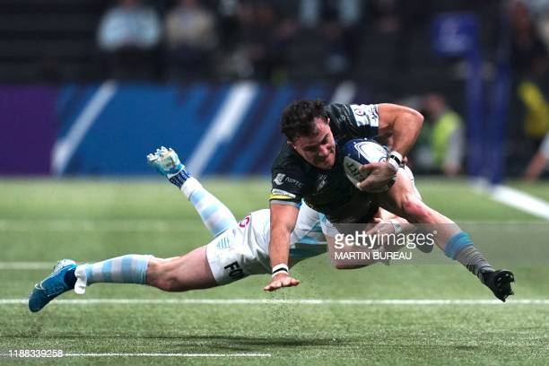 TOPSHOT Ospreys wing Luke Morgan is tackled during the European Champions Cup rugby union match between Racing 92 and Ospreys at Paris La Defense...