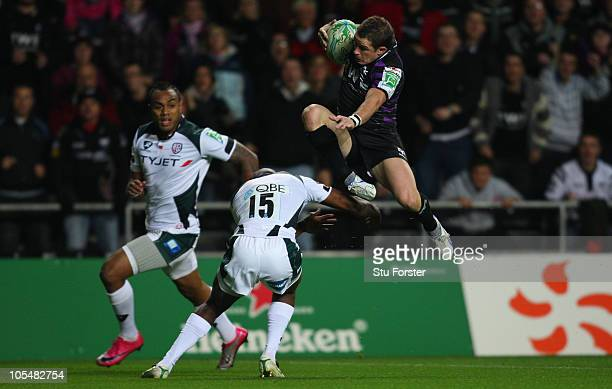 Ospreys winger Shane Williams trys to go over Irish full back Topsy Ojo during the Heineken Cup Pool 3 match between Ospreys and London Irish at...