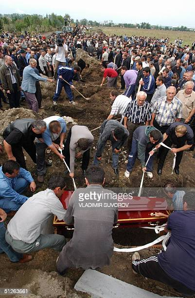 Ossetians bury a coffin with victim of Beslan' school hostage drama at the cemetery in Beslan North Ossetia 05 September 2004 The first funerals for...