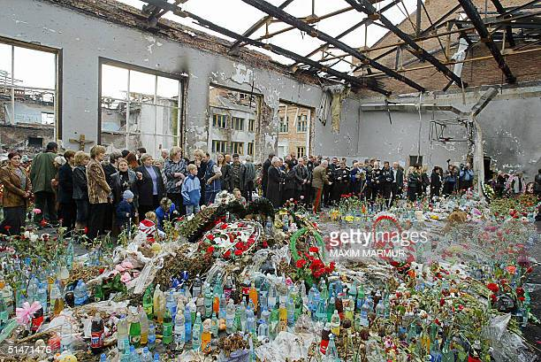 Ossetians mourn at the destroyed school's gymnasium in Beslan 12 October 2004 This week marks the end of the traditional 40 day mourning period since...