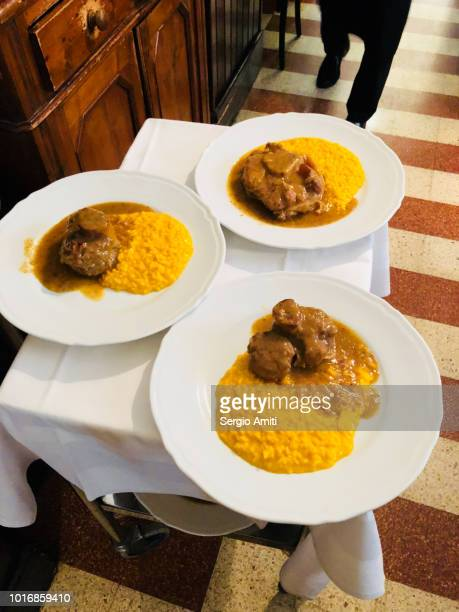ossobuco con risotto alla milanese - milanese stock pictures, royalty-free photos & images