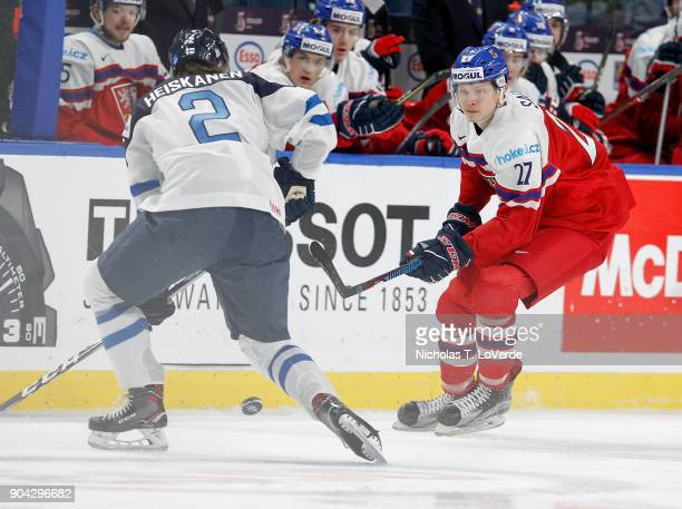 Ostap Safin of Czech Republic skates the puck up ice against Miro Heiskanen of Finland during the first period of play in the IIHF World Junior...