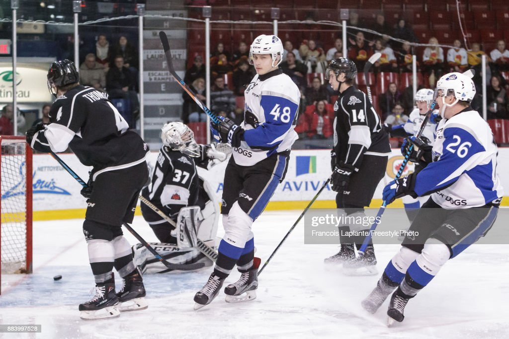 Ostap Safin #48 of the Saint John Sea Dogs looks on as he scores his first period goal against Tristan Berube #37 of the Gatineau Olympiques on December 1, 2017 at Robert Guertin Arena in Gatineau, Quebec, Canada.