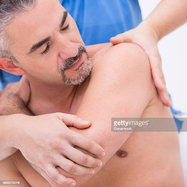 osteopath practising - human arm stock pictures, royalty-free photos & images