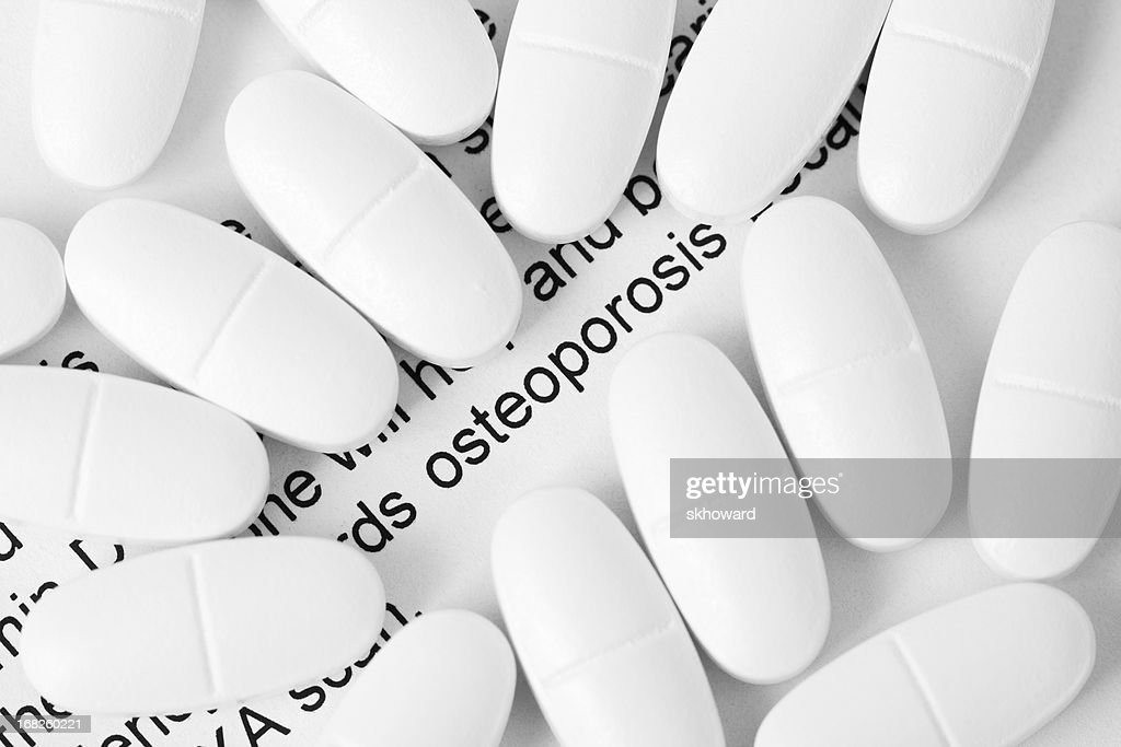Osteoporosis and Calcium Pills : Stock Photo