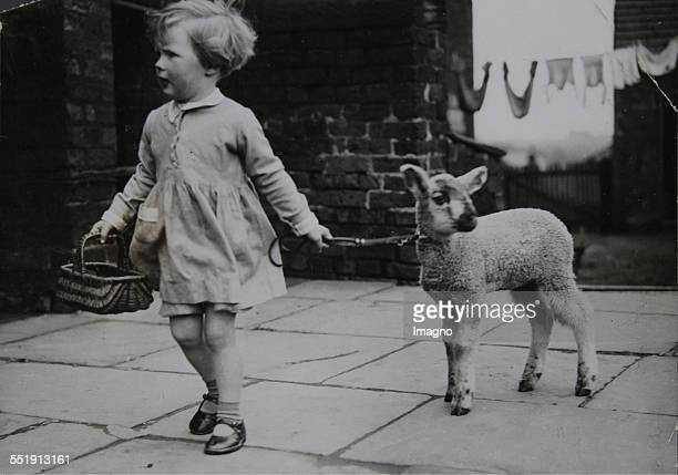 'Osterfreuden ' [Little girl with lamb] About 1930 Photograph