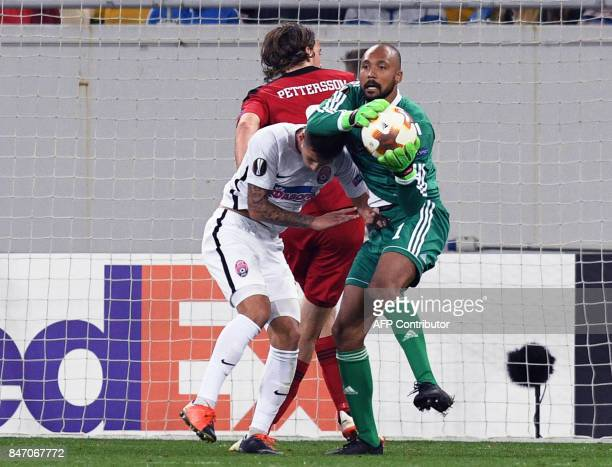 Ostersund goalkeeper Aly Keita vies with Zorya midfielder Artem Gromov during during the UEFA Europa League Group J football match between Zorya...