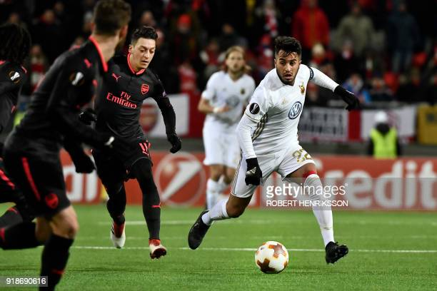 Ostersund's Brwa Nouri and Arsenal's Mesut Özil vie for the ball during the UEFA Europa League round of 32 first leg football match of Ostersund FK...