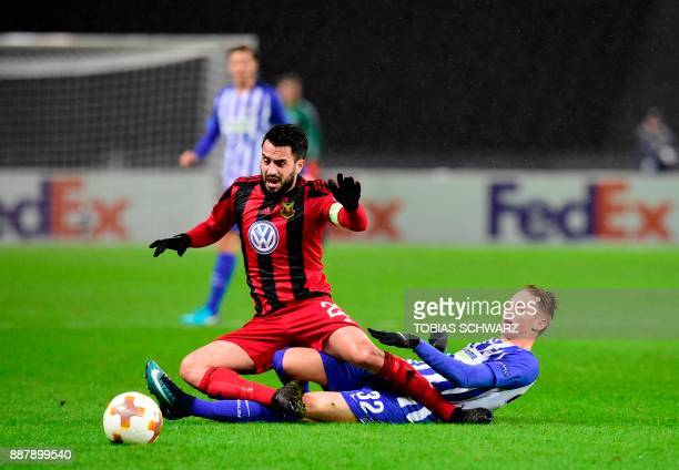 Ostersund's Brwa Nouri and Hertha Berlin's German forward Palko Dardai vie for the ball during the UEFA Europa League group J football match Hertha...
