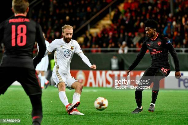 Ostersund's Curtis Edwards and Arsenal's Ainsley MaitlandNiles vie for the ball during the UEFA Europa League round of 32 first leg football match of...