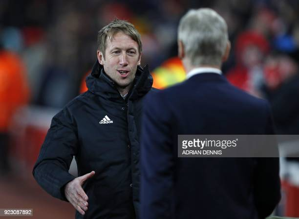 Ostersunds' English manager Graham Potter shakes hands with Arsenal's French manager Arsene Wenger ahead of the second leg of the Europa League Round...