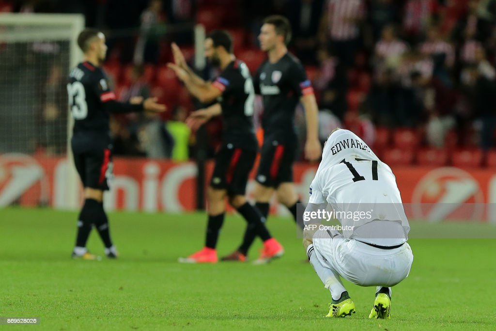 Ostersunds' English midfielder Curtis Edwards reacts at the end of the UEFA Europa League group I football match Vitoria SC vs Marseille at the D. Afonso Henriques stadium in Guimaraes on November 2, 2017. /